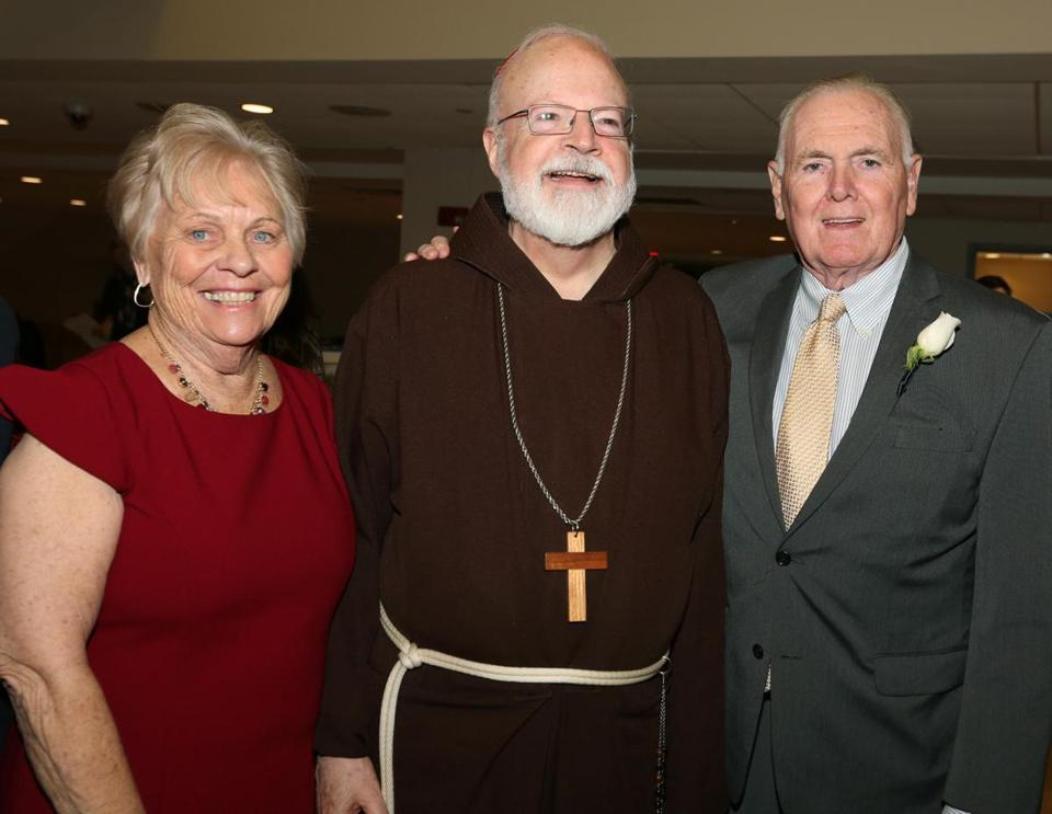 2-28-2019 Dorchester, Mass. More than 300 guests attended 2019 Paraclete Annual reception celebrating Ambaasador and Cathy Flynn and family held at Boston College High School. L. to R. are Cathy Flynn, Cardinal Sean O'Malley and Ambassador Ray Flynn. Photo by Bill Brett for the Boston Globe