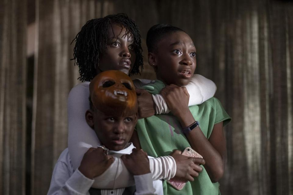 "(Clockwise from top left) Lupita Nyong'o, Shahadi Wright Joseph, and Evan Alex in the film ""Us,"" directed by Jordan Peele."
