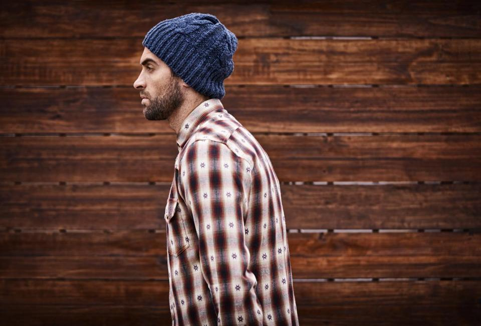 "A man thought this stock photo of ""a handsome young man in trendy winter attire against a wooden background"" was him. He saw it in an MIT story about hipsters and accused the university of using his image without his permission. It wasn't him, just a generic stock photo of a model. (Getty Image Stock)"