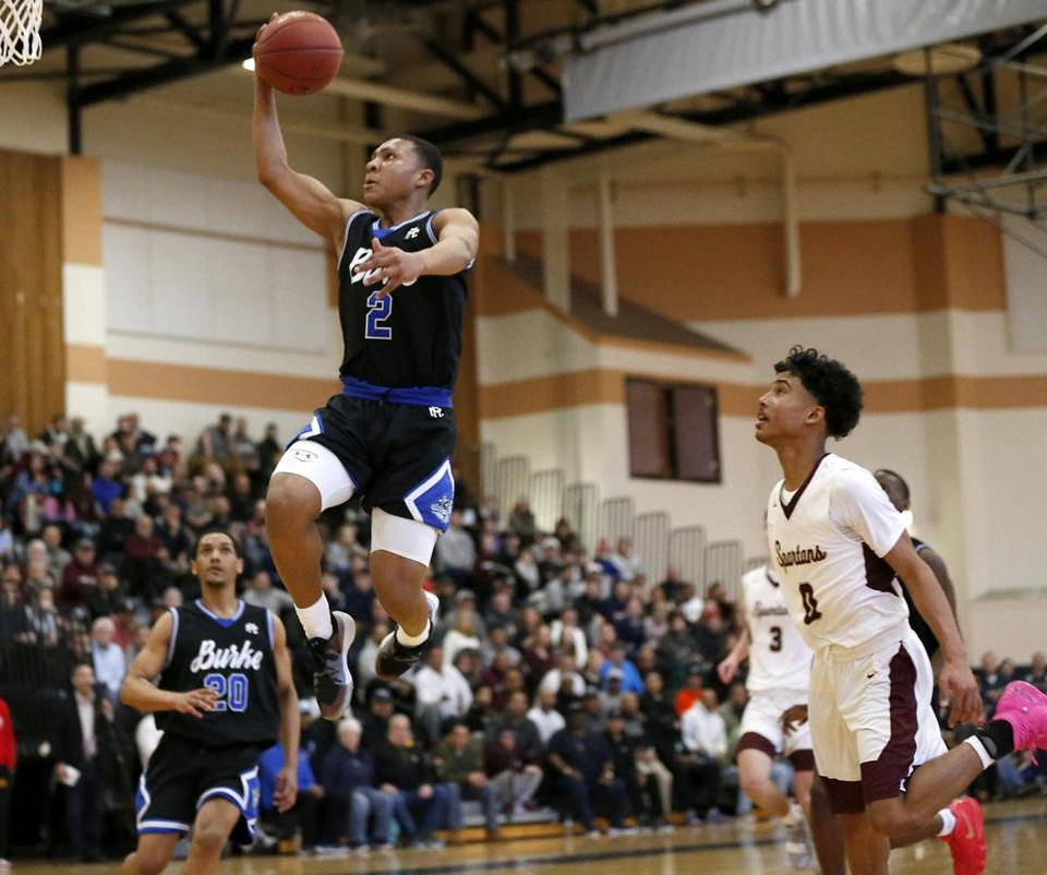 Taunton MA 3/9/19 Burke High School Levar Williams makes a layup over Bishop Stang High School Joey Silva during second quarter action of the MIAA Division D2 South boys' basketball final at Taunton High School. (photo by Matthew J. Lee/Globe staff) topic: reporter: