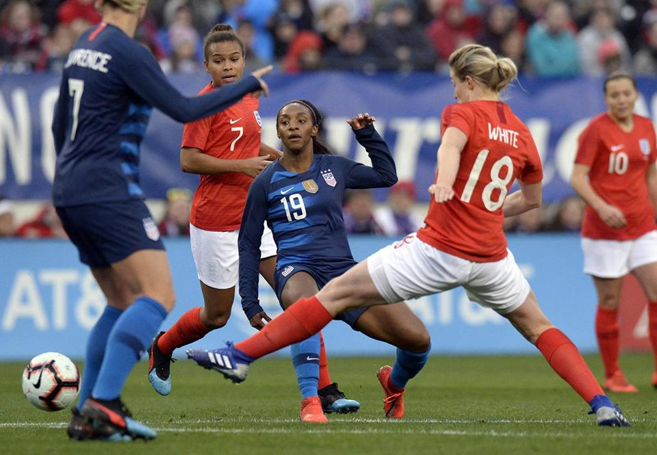 United States defender Crystal Dunn (19) passes the ball against England  during the first f0ea2a315