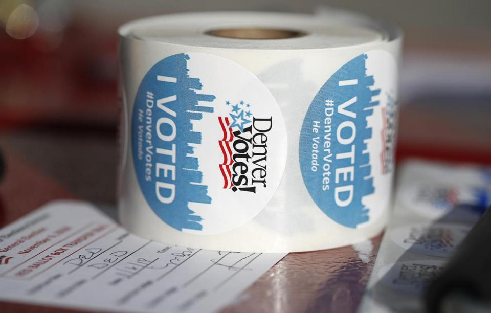 FILE--In this Tuesday, Nov. 6, 2018, file photograph, a roll of stickers sits on a table to be handed out by election judges as voters deposit their ballots at the Denver Elections Division drop off location in front of the City/County Building in Denver. Colorado's Democrat-controlled Legislature has approved a bill Thursday, Feb 21, 2019, to join other states in casting their presidential electoral votes for the winner of the national popular vote. (AP Photo/David Zalubowski, File)