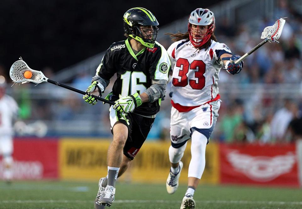 HEMPSTEAD, NY - AUGUST 1: Mike Stone #16 of the New York Lizards defended by Josh Hawkins #33 of the Boston Cannons at James M. Shuart Stadium on August 1, 2015 in Hempstead, New York. (Photo by Adam Hunger/Getty Images)