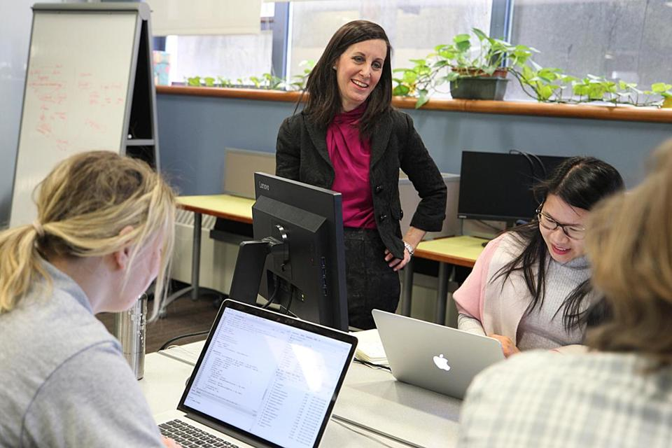Shereen Shermak, executive director of the Boston Women's Workforce Council, stood in the council's workspace at Boston University's Hariri Institute for Computing.
