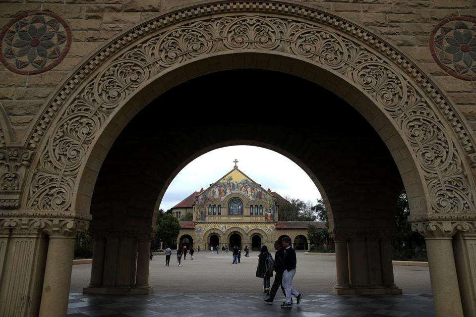 Erica Olson and Kalea Woods say they were denied a fair opportunity to gain legitimate admission to elite colleges, and that their Stanford degrees were devalued, by criminal racketeering charges leveled by federal prosecutors.