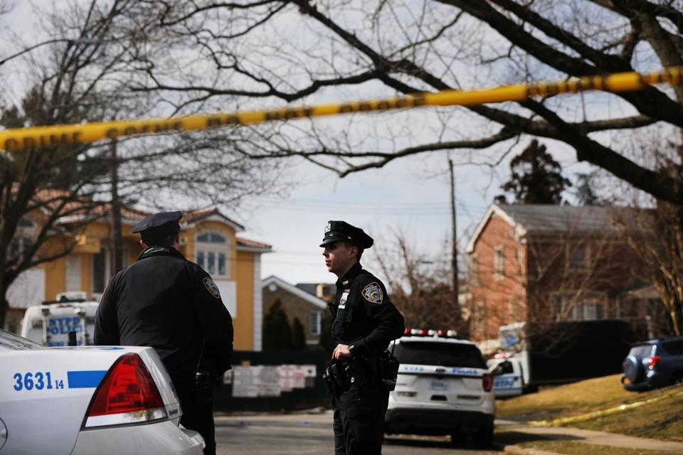 Police stood near where reputed mob boss Francesco Franky Boy Cali was gunned down earlier this week in Staten Island.