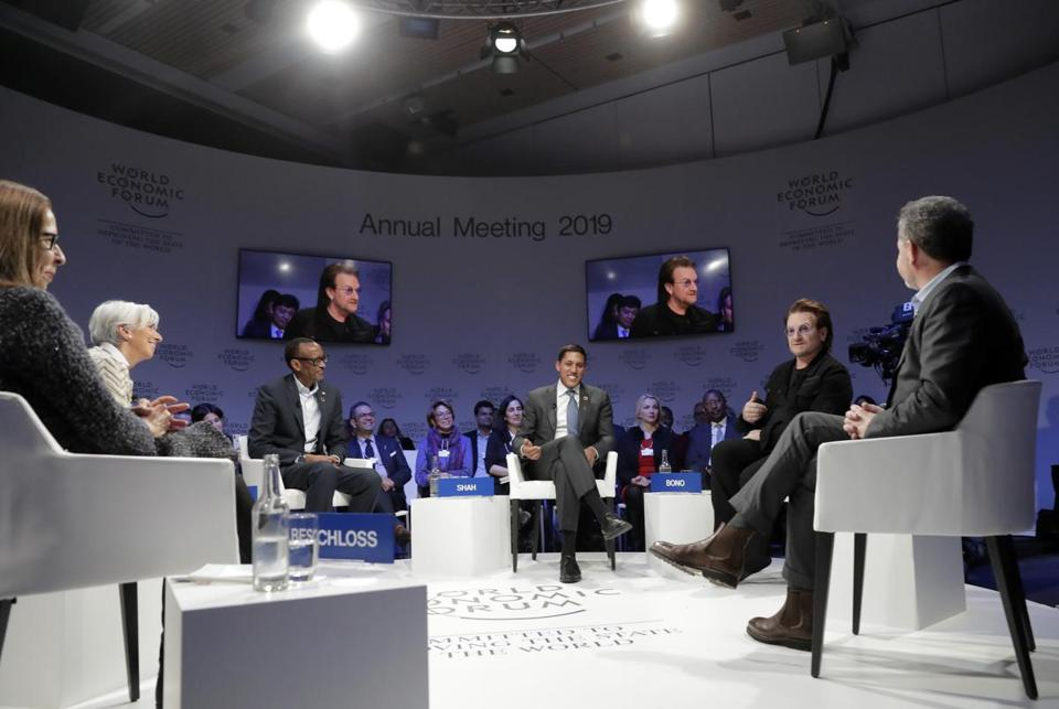Bono (second from right) and TPG's Bill McGlashan (far right) appeared at a panel at the World Economic Forum in Davos, Switzerland, in January.