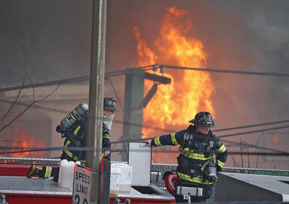 Firefighters battling a massive fire at New England Casket Company on Bennington Street.