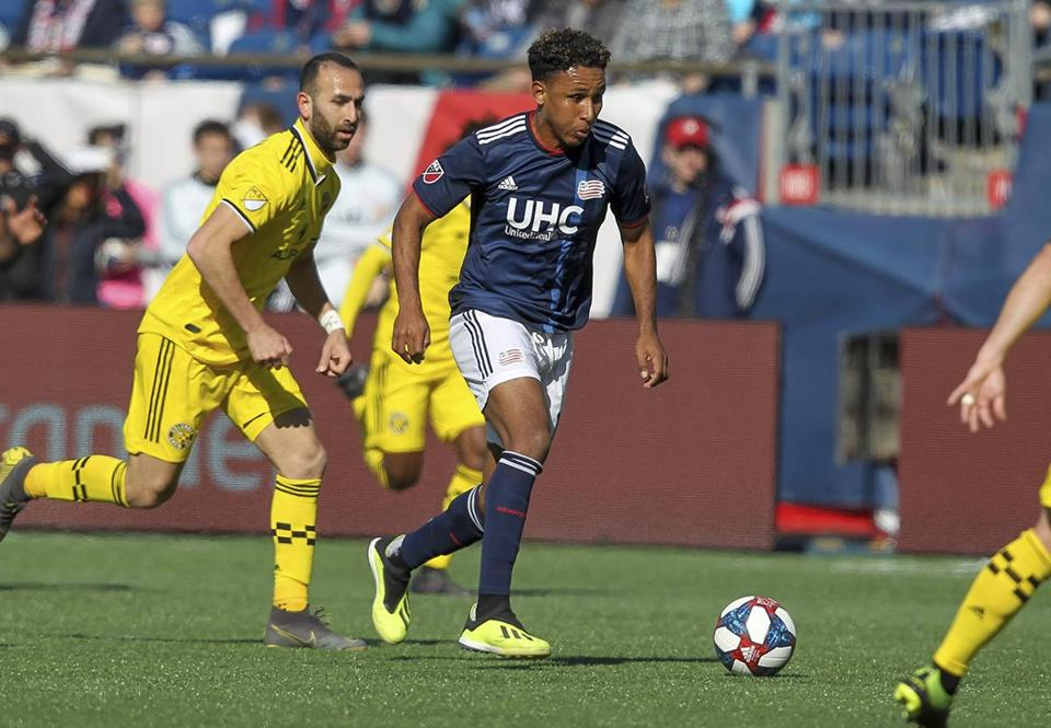 New England Revolution's Juan Agudelo dribbles the ball during the first half of an MLS soccer game against the Columbus Crew, Saturday, March 9, 2019, in Foxborough, Mass. (AP Photo/Stew Milne)