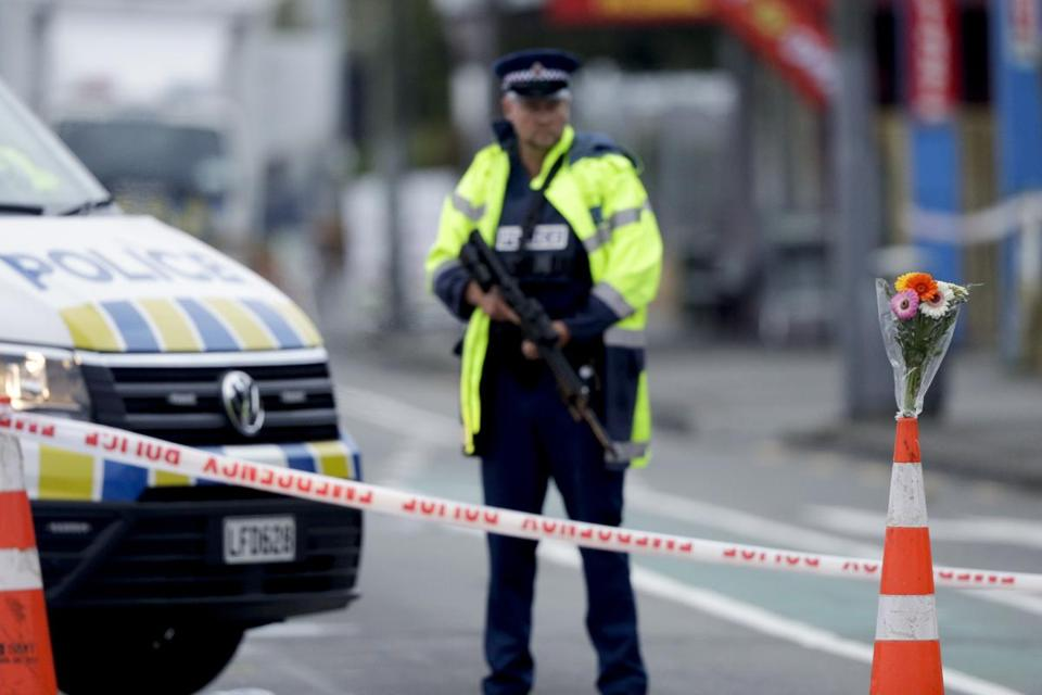 A police officer stood guard Saturday near the Linwood mosque, where seven people were killed, in Christchurch, New Zealand.