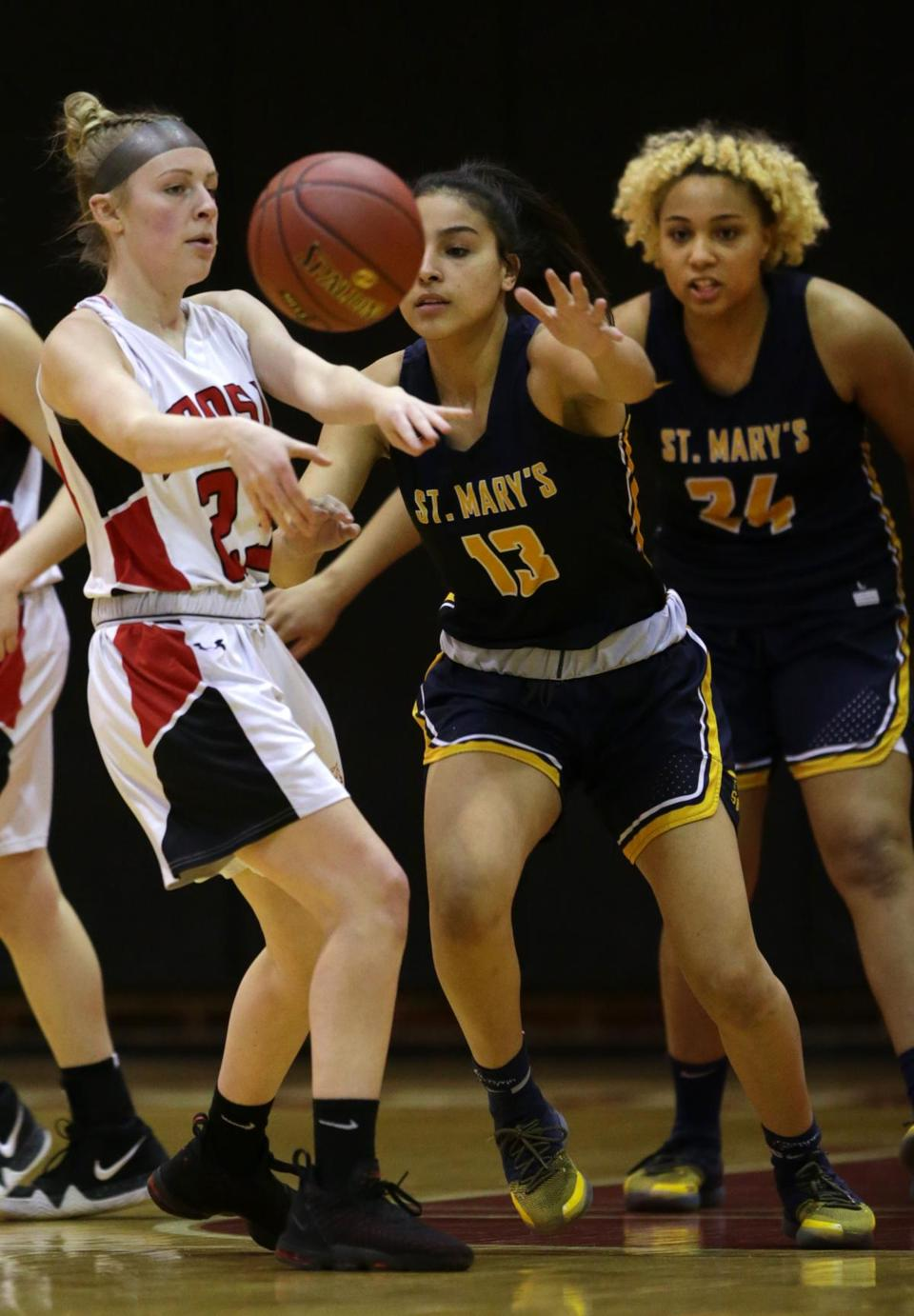 Hoosac's Alison Mendel (left) battlles with St. Mary's Pamela Gonzalez (13) for a loose ball.