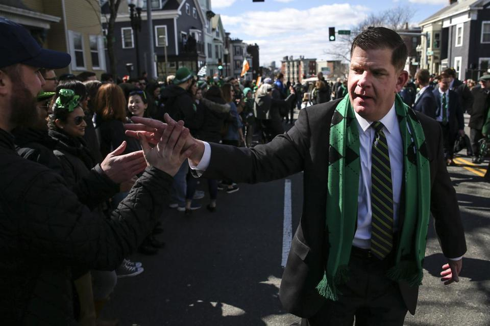 Boston Mayor Martin J. Walsh shook hands with people in the crowd.