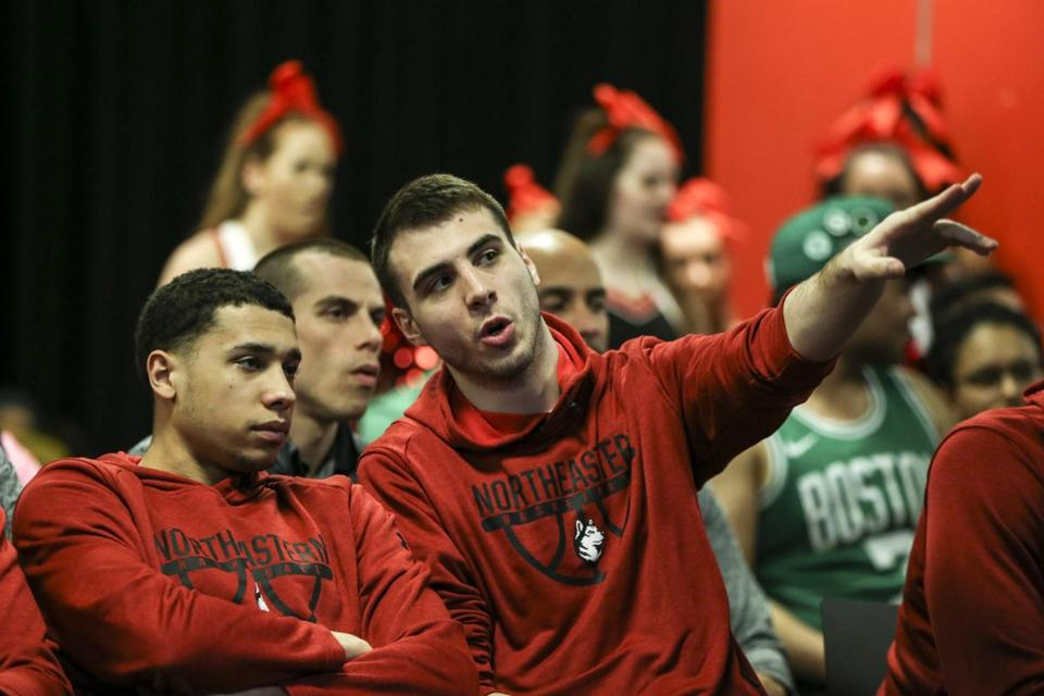Boston, MA--03/17/2019--Northeastern guard Vasa Pusica (right) points to the TV during an NCAA Tournament Selection Sunday watch party in the Curry Student Center at Northeastern University. (Nathan Klima for The Boston Globe) Topic: northeasternbracket Reporter: