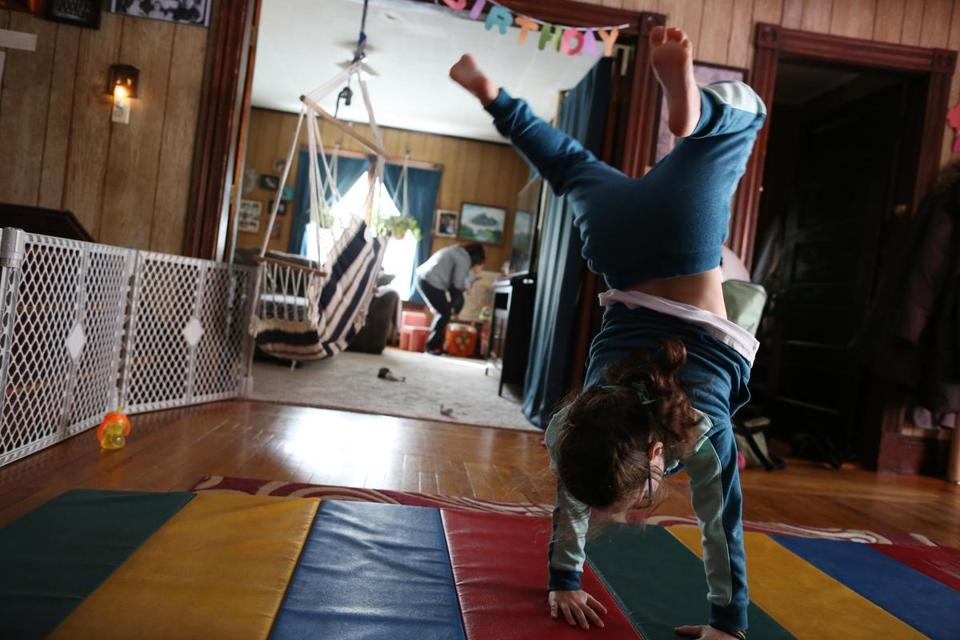 Suzor's daughter Joley turned cartwheels as Suzor tended to a 16-month-old foster child.