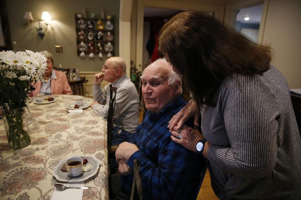 Westwood, MA, 03/21/2019 -- Program Assistant Gloria Cabral (R) chats with William Sullivan during high tea at the Julia Ruth House Adult Day Care Center in Westwood. Biogen's announcement is discouraging for patients and families with dementia. (Jessica Rinaldi/Globe Staff) Topic: 22biogenpatientspic Reporter: