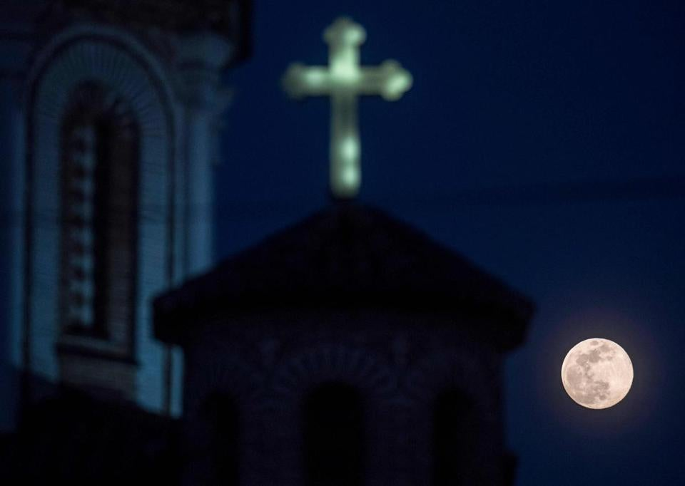 TOPSHOT - A full moon, announcing the end of the winter season, rises over a church at Skopje, North Macedonia on March 20, 2019. [Photo taken by Robert ATANASOVSKI / AFP] ROBERT ATANASOVSKI / AFP / Getty Images