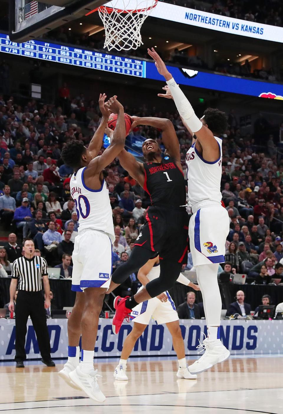Northeastern's Shawn Occeus could find little room against the Kansas defense.