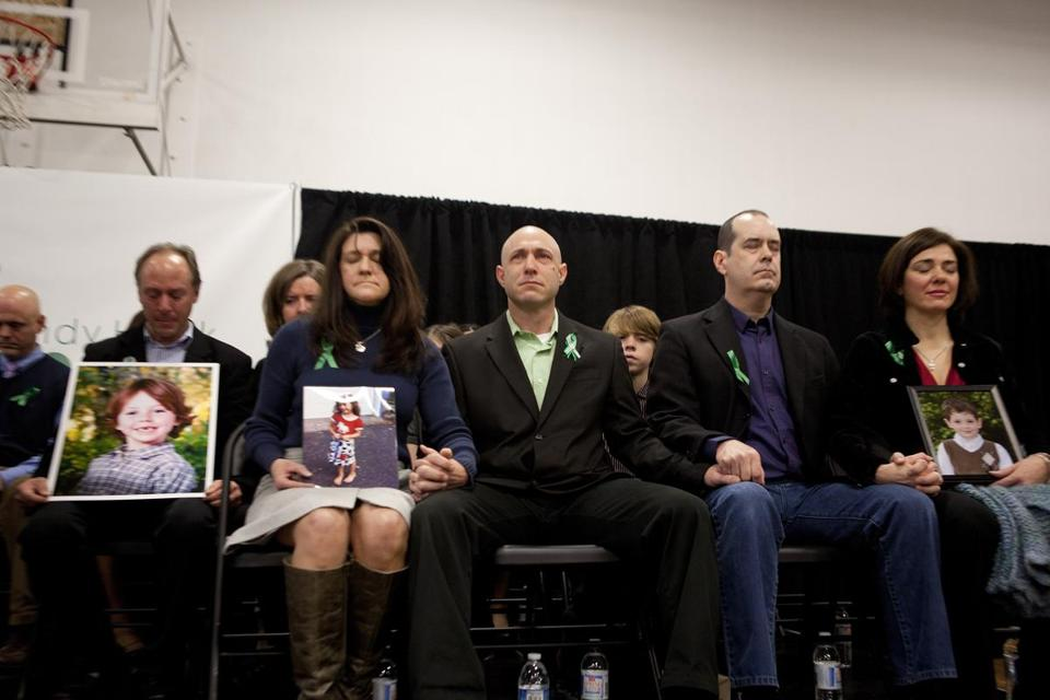 Jeremy Richman (center) with his wife Jennifer Hensel, who held a photo of their daughter, during a 2013 news conference.