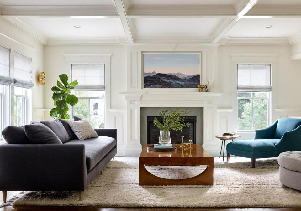 The half-moon cutouts on either end of the burlwood veneer coffee table, from Williams Sonoma Home, remind designer Lisa Kreiling of smiley faces.