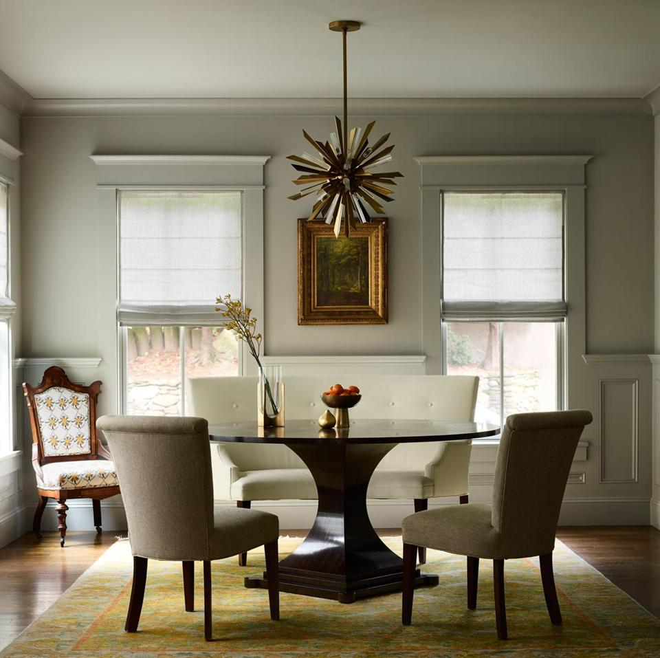 In the dining room, Kreiling reupholstered an antique chair in fabric by Lincoln-based designer Mally Skok to coordinate with the cheerful rug from Bloomingdale's.