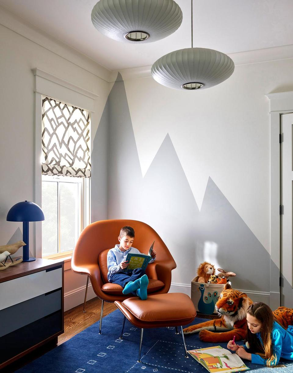 The Eero Saarinen Womb chair and a mountain mural hand-painted by Pauline Curtiss of Patina are highlights in the boy's bedroom.