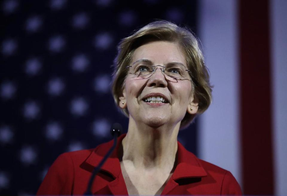In this Feb. 22, 2019, photo, Democratic presidential candidate Sen. Elizabeth Warren, D-Mass., speaks at the New Hampshire Democratic Party's 60th Annual McIntyre-Shaheen 100 Club Dinner in Manchester, N.H. Several Democratic presidential candidates are embracing reparations for the descendants of slaves _ but not in the traditional sense. Over the past week, Senators Kamala Harris, Elizabeth Warren and former Obama cabinet secretary Julian Castro spoke of the need for the U.S. government to reckon with and make up for slavery. But instead of backing the direct compensation for African-Americans, they are talking about more universal policies that would also benefit blacks. (AP Photo/Elise Amendola)