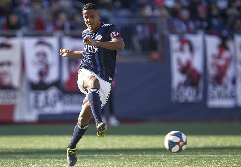 New England Revolution's Michael Mancienne passes the ball during the first half of an MLS soccer game against the Columbus Crew, Saturday, March 9, 2019, in Foxborough, Mass. (AP Photo/Stew Milne)