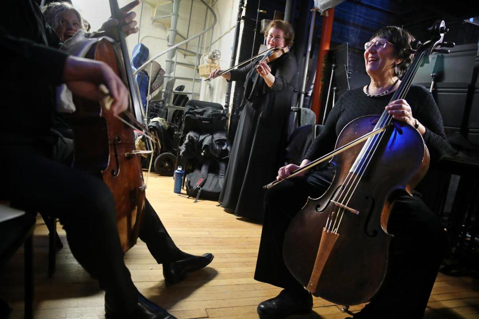 Cellist Sarah Freiberg (right) joined others warming up before their first show of the weekend at Jordan Hall on Friday.