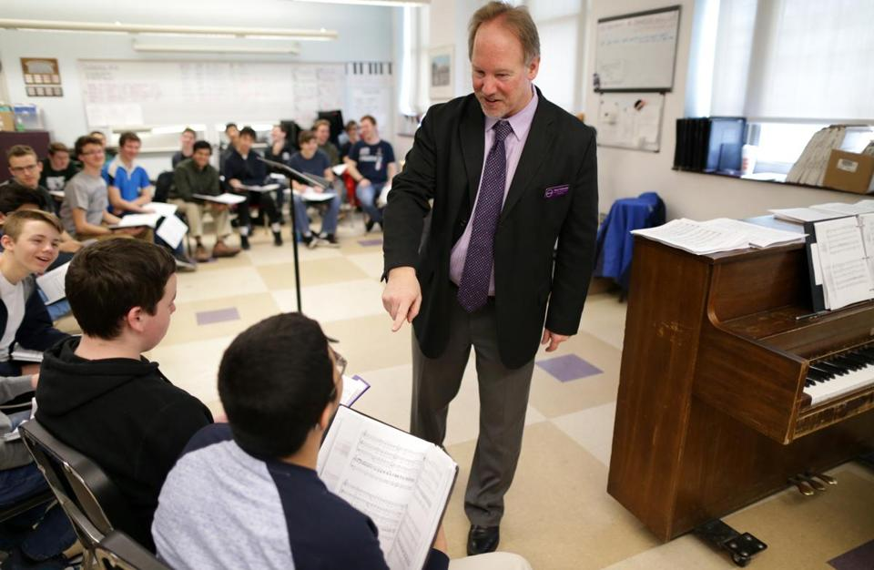 Kevin McDonald, Young Men's Chorus conductor, at a Boston Latin School rehearsal.