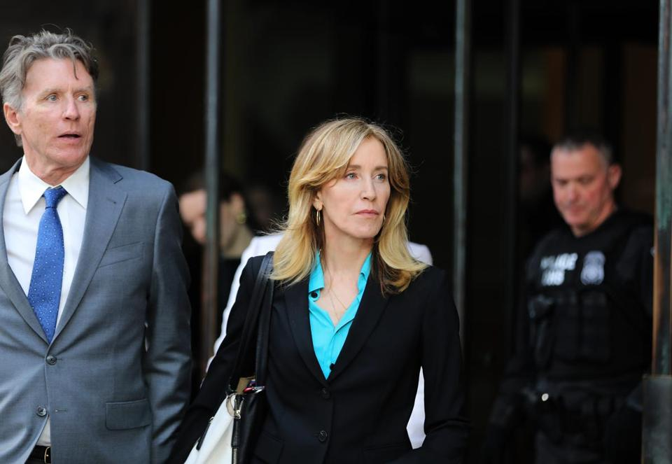 Boston, MA - 4/3/19 Actress Felicity Huffman (cq) leaves court. More parents accused of bribery in the college admissions scandal appear at federal court. Photo by Pat Greenhouse/Globe Staff Topic: 04collegescandal