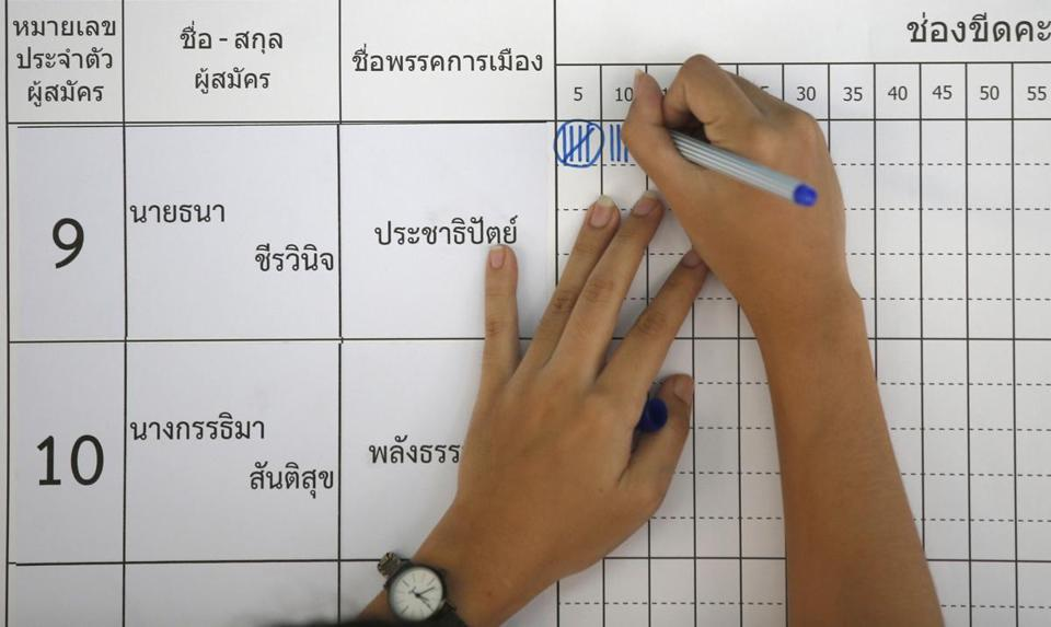 On Sunday, a Thai election officer began counting votes at a polling station in Bangkok.