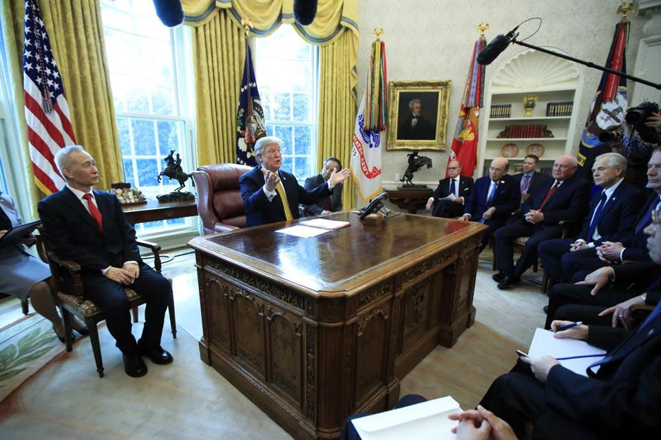 President Donald Trump speaks to reporters during a meeting with China's Vice Premier Liu He, left, in the Oval Office of the White House in Washington, Thursday, April 4, 2019. (AP Photo/Manuel Balce Ceneta)