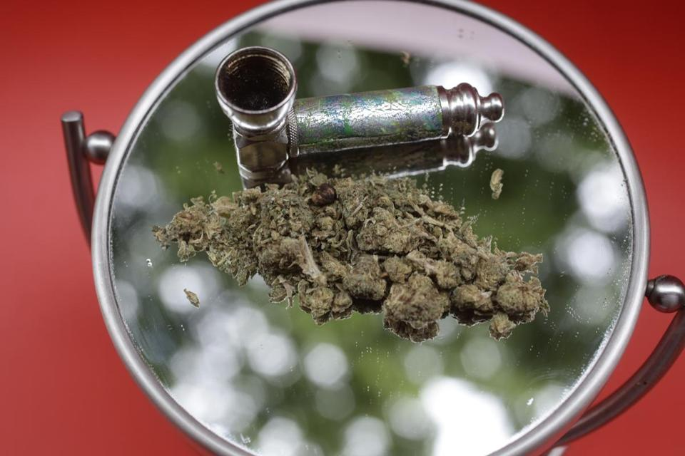 In this June 20, 2018 photo, marijuana and a pipe used to smoke it are displayed on a mirror, in New York. New York state lawmakers who delivered a budget on time are now turning their attention to thorny debates over legalizing recreational marijuana and renewing New York City's rent regulations. One big question concerning marijuana legalization relates to whether counties would have to opt out, or opt in, to allowing retail marijuana shops. (AP Photo/Peter Morgan)