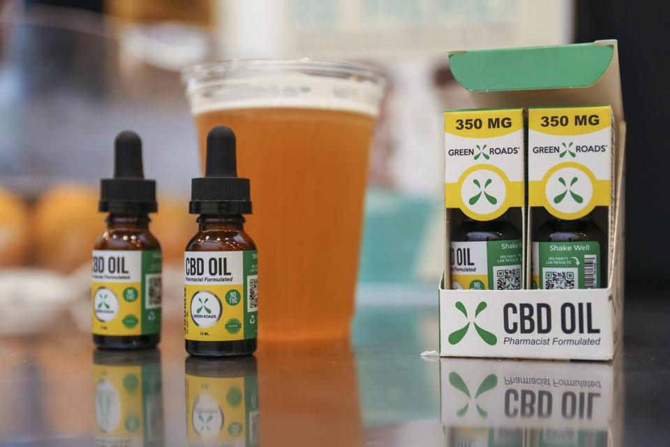 In this Friday, Jan. 4, 2018 photo, Green Roads CBD-oil spikes coffee, beer, and other beverages for an extra $2 at Colada in Fort Lauderdale, Fla. South Florida restaurants are buzzing over CBD in recent months, touting the oil's ability to treat everything from chronic pain to anxiety. Here's the problem: Some CBD-laced foods contain trace amounts of THC (tetrahydrocannabinol), the psychoactive substance in marijuana that produces a euphoric high. THC is illegal in Florida for those without a medical marijuana card. (Jennifer Lett/South Florida Sun-Sentinel via AP)