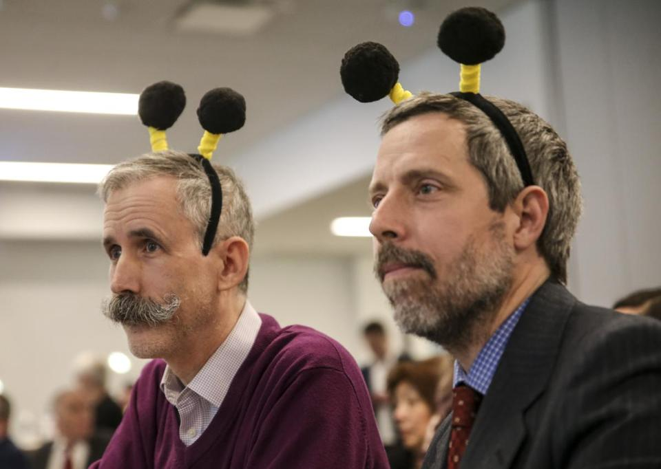 Judges Will Johnston (left) and Peter Chipman got in the spirit of Thursday's corporate spelling bee.