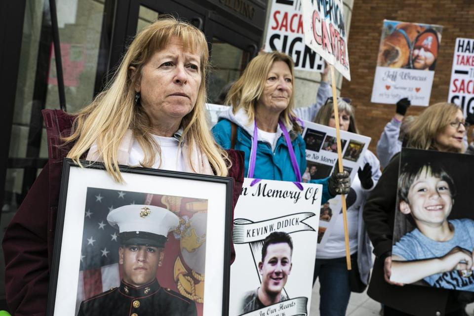 CAMBRIDGE, MA - 04/12/2019 Kathleen Scarpone holds a photo of her son, Sgt. Joseph Scarpone, during a demonstration outside of the Arthur M Sackler Museum where parent's of opiod victims demand the removal of the Sackler name from any public space. Scarpone, of Kingston, NH, lost her son one month shy of his 26th birthday in 2016. (Erin Clark for The Boston Globe)