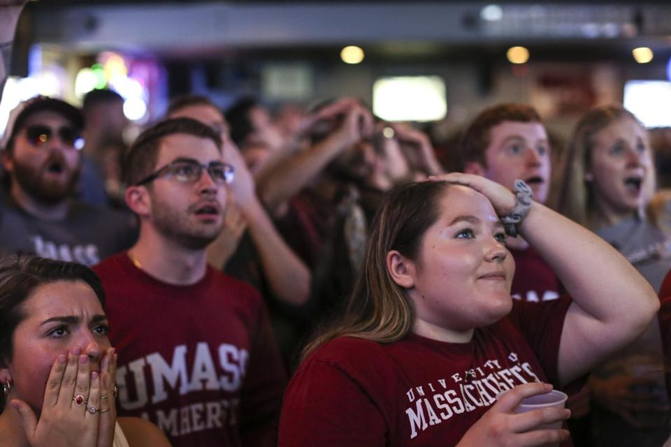 Amherst, MA--04/13/2019--UMass Amherst students watching the Frozen Four championship game at Spoke on Saturday night react to the impeding loss during the last seconds of the game. (Nathan Klima for The Boston Globe) Topic: 14amherst Reporter: