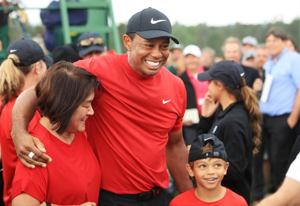 Tiger Woods with his son Charlie Axel as he comes off the 18th hole following his victory in the Masters.