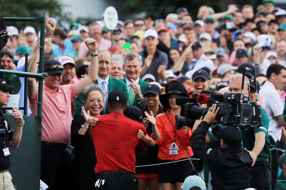 AUGUSTA, GEORGIA - APRIL 14: Tiger Woods of the United States celebrates with his son Charlie Axel, his mother Kultida and daughter Sam Alexis as he leaves the 18th green after winning during the final round of the Masters at Augusta National Golf Club on April 14, 2019 in Augusta, Georgia. (Photo by David Cannon/Getty Images)