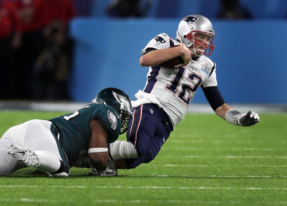 Minneapolis, MN 2/4/2018:Patriots quarterback Tom Brady is tackled by the Eagles Brandon Graham as he tries to scramble for some late first half yardage. The New England Patriots play the Philadelphia Eagles in Super Bowl LII at US Bank Stadium in Minneapolis. (Jim Davis/Globe Staff)