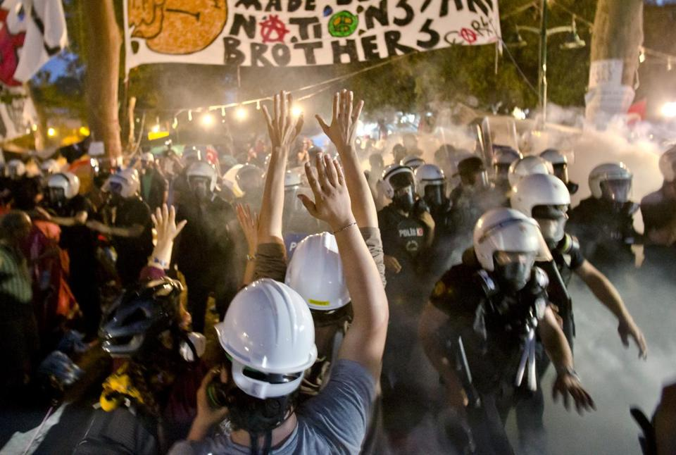 Protesters try to resist the advance of riot police in Gezi Park, Istanbul, Saturday.