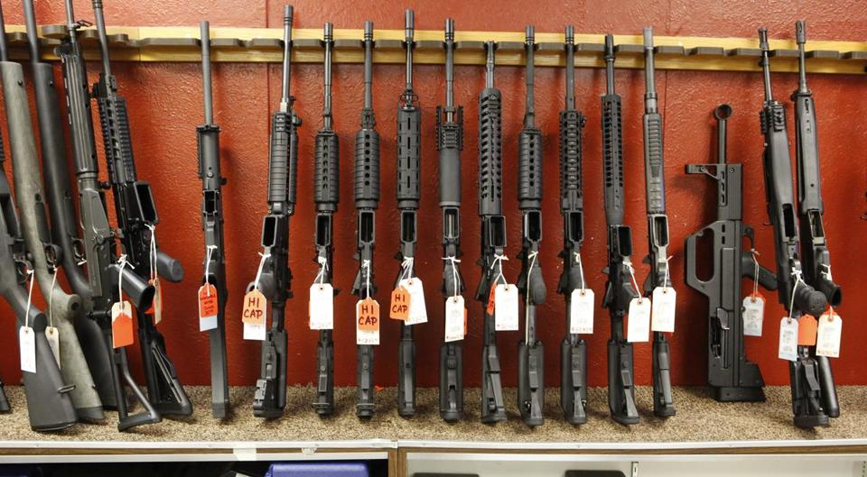 This photo taken on Thursday, June 27, 2013, shows a rack of rifles at Firing-Line gun store in Aurora, Colo., that can't be sold in Colorado after June 30 because their magazines hold more than 15 rounds. Limits on ammunition magazines and universal background checks, signature pieces of Colorado Democrats� gun-control legislation in response to mass shootings, take effect July 1, even as county sheriffs fight to overturn the new laws. (AP Photo/Ed Andrieski)