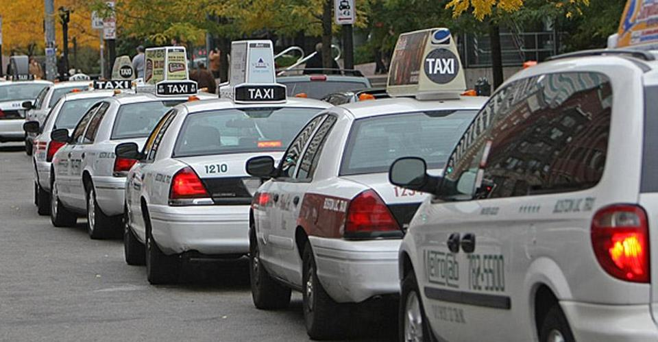 Taxi cabs were parked on Atlantic Avenue near the bus terminal at South Station.