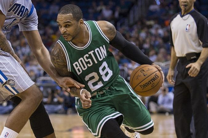 Boston Celtics' Jameer Nelson (28) dribbles by Orlando Magic's Channing Frye (8) during the second half of an NBA basketball game in Orlando, Fla, Tuesday, Dec. 23, 2014. (AP Photo/Willie J. Allen Jr.)