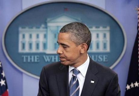 The Obama-no-fro has been graying from Day One, as is to be expected.