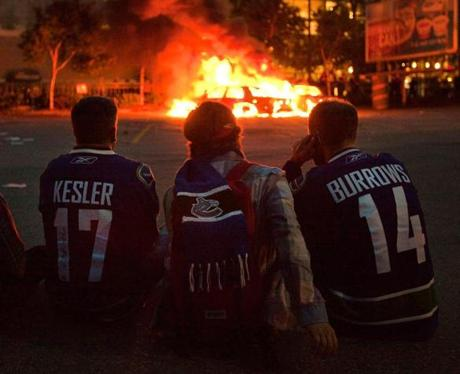 Fans watched police cars burn in the aftermath.