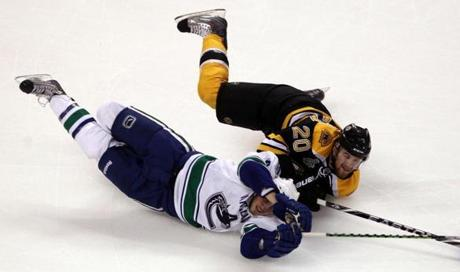 Boston's Daniel Paille took down Vancouver's Chris Tanev during Game 6.
