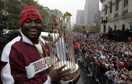 Ortiz carried the Commissioner's Trophy that had eluded Boston fans for 86 years.