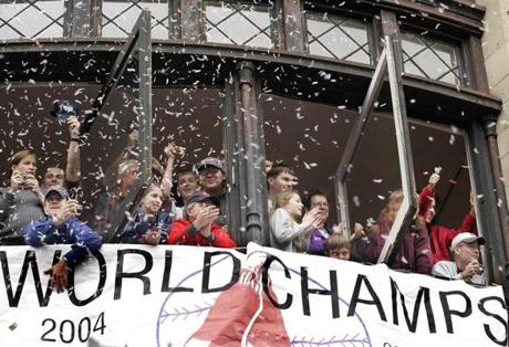 Revelers lined the windows and porches of buildings along the parade route to congratulate the Red Sox.