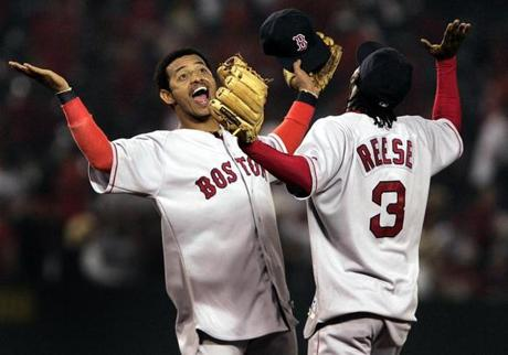 Shortstop Orlando Cabrera and second baseman Pokey Reese celebrated after defeating the Angels in Game 2 of the ALDS.